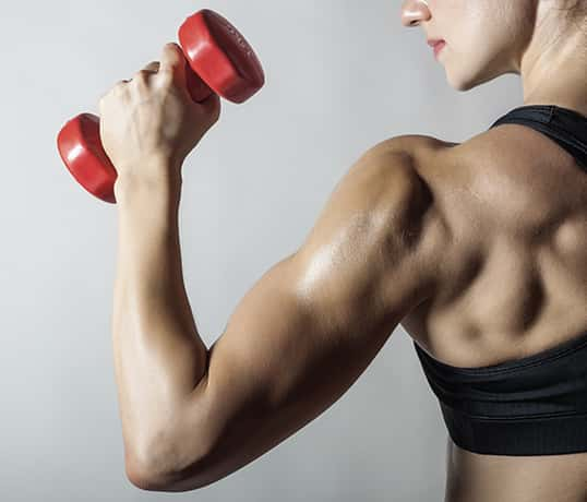 Exercising forearms using small weights.